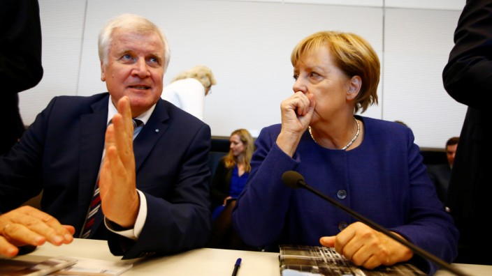 FILE PHOTO: German Chancellor Merkel, leader of the Christian Democratic Union Party (CDU) and Seehofer, head of the CSU attend their first parliamentary meeting after general election in Berlin