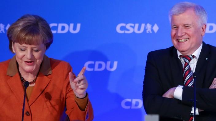 FILE PHOTO: German Chancellor Merkel and Bavarian CSU leader Seehofer meet in Munich