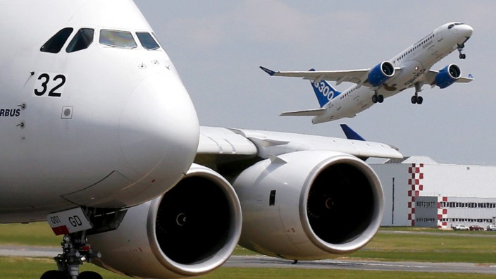 FILE PHOTO - Bombardier CS300 aicraft takes off to participate a flying display as Airbus A380 waits on the taxiway during the 51st Paris Air Show at Le Bourget airport near Paris
