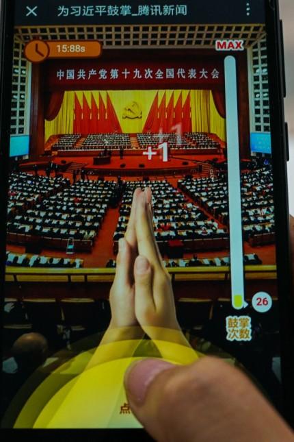 Handyspiel aus China: Applaus für Xi: Ein Klatschspiel fürs Handy ist der Renner in China.
