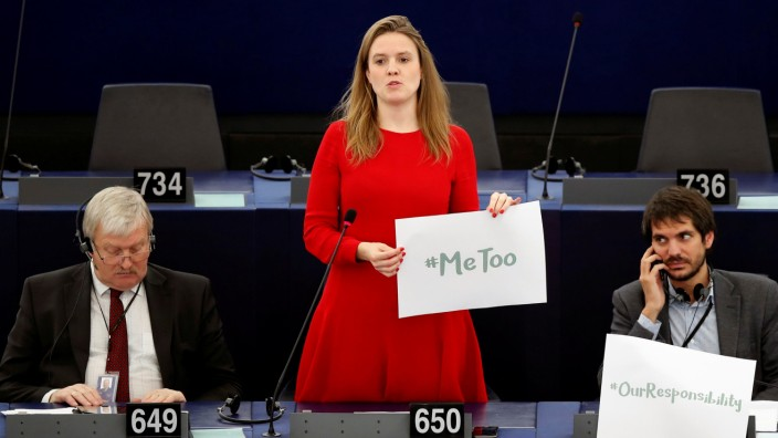 European Parliament member Terry Reintke holds a placard with the hashtag 'MeToo' during a debate to discuss preventive measures against sexual harassment and abuse in the EU at the European Parliament in Strasbourg