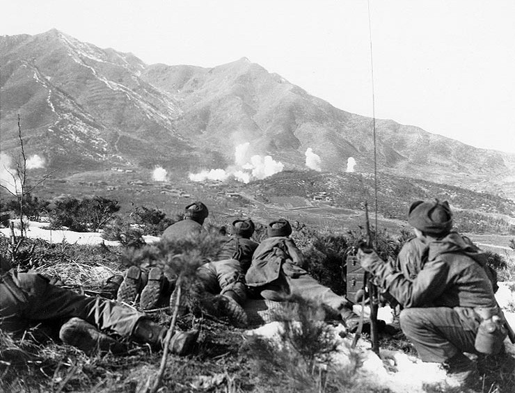 U.S. Army personnel watch the Communist-held area as U.N. forces bombard the vicinity with white phosphorous shells