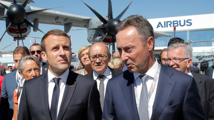 French President Emmanuel Macron and President and CEO of Airbus Fabrice Bregier visit the 52nd Paris Air Show in Le Bourget