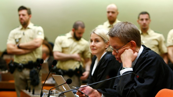 Heer and Sturm lawyers of defendant Zschaepe, accused of helping to found neo-Nazi cell called NSU, are pictured before trial at a courtroom in Munich