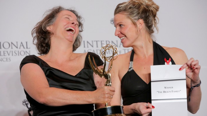 Beatrice Kramm and Lucia Haslauer pose with their award for their short-form series 'The Braun Family' at the International Emmy Awards in Manhattan, New York.