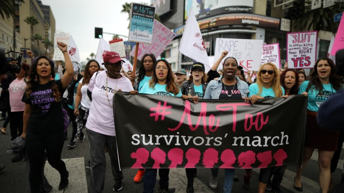 People participate in a protest march for survivors of sexual assault and their supporters in Hollywood