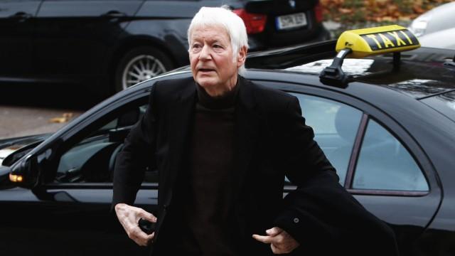 Anton Schlecker arrives for the trial at a regional court in Stuttgart