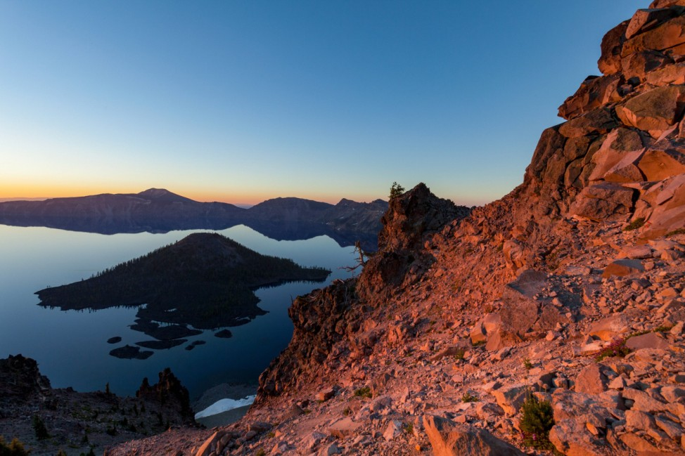 Wizard Island and the still waters of Crater Lake at dawn the deepest lake in the U S A part of t