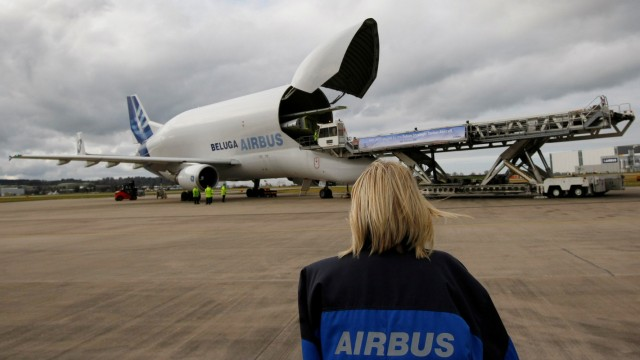 FILE PHOTO: An Airbus worker watches the first pair of wings for a new tanker aircraft belonging to Britain's Royal Air Force being loaded onto a Beluga transport plane at the company's Broughton site in North Wales