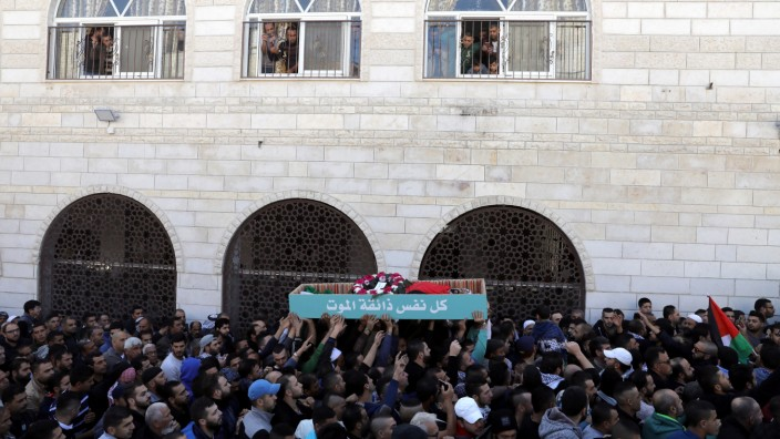 Palestinians carry the body of Bassel Mustafa Ibrahim during his funeral in the village of Anata, on the edge of Jerusalem