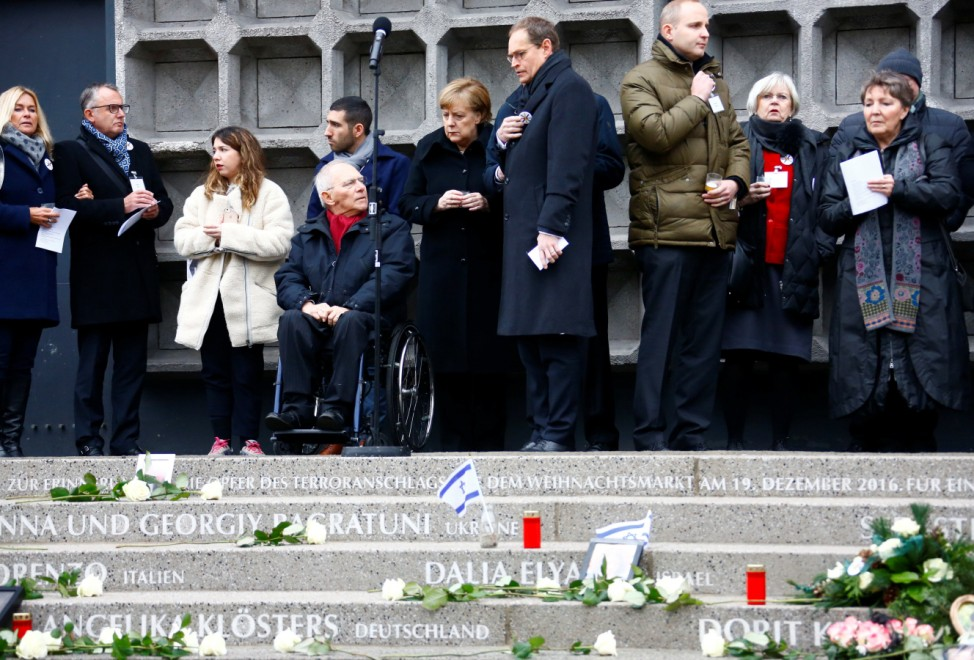 German Chancellor Merkel and Berlin's Mayor Mueller attend a ceremony at Breitscheidplatz square for the one year anniversary of a truck attack in Berlin
