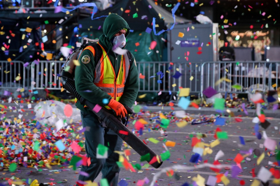 A New York City Department of Sanitation worker cleans the streets after the New Year celebrations in Times Square in New York