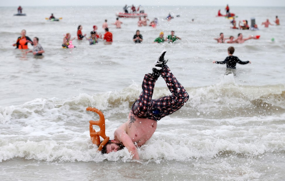 Participant jumps in North Sea during annual New Year's plunge event in Ostend