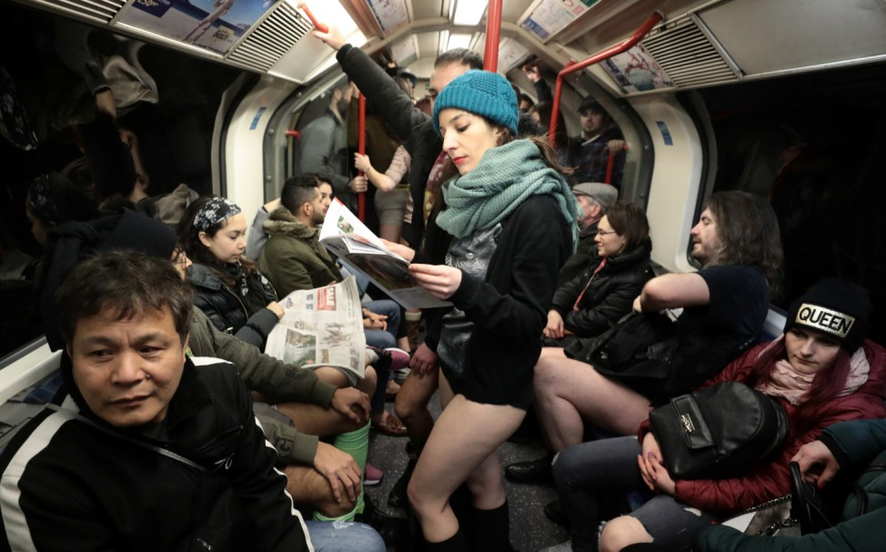 Passengers without trousers travel on a London Underground train as part of the 'No Trousers on the Tube Day' event, in London