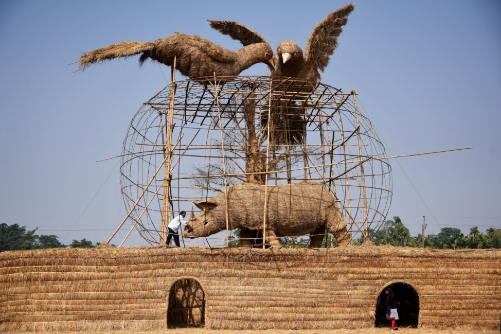 A worker prepares a makeshift cottage called âĜBhelagharâĝ ahead of the Magh Bihu festival in Morigaon district