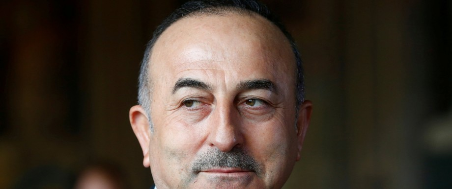 Turkish Minister of Foreign Affairs Mevlut Cavusoglu attends a news conference in Goslar