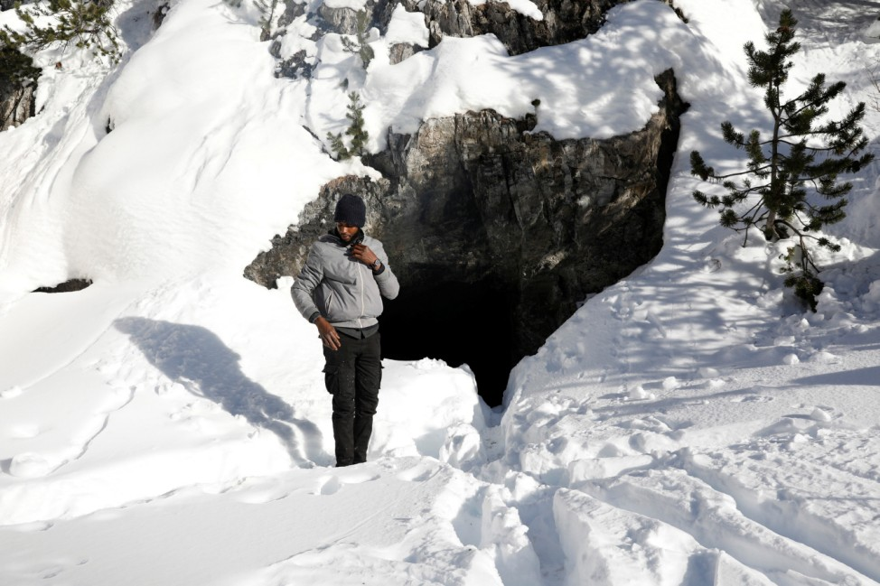 The Wider Image: Migrants risk death crossing Alps to reach France