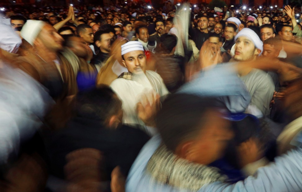 Egyptian Sufi Muslims practice ritualized Zikr (invocation) as they celebrate Moulid Al-Hussein, the birthday of Prophet Mohammad's grandson Hussein, outside the Al-Hussein mosque in old Cairo