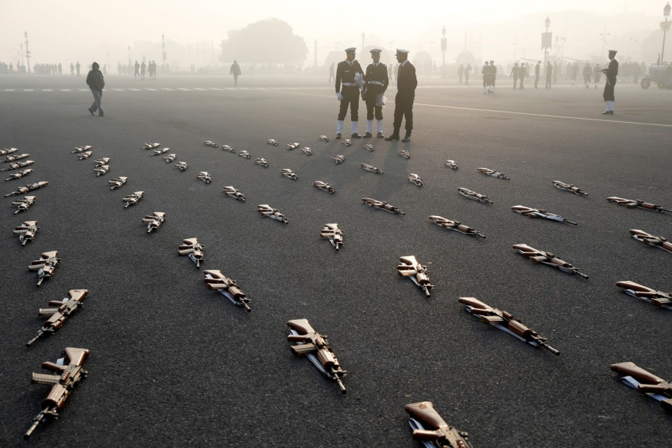 Indian Navy soldiers stand guard to rifles during a rehearsal for the Republic Day parade on a winter morning in New Delhi
