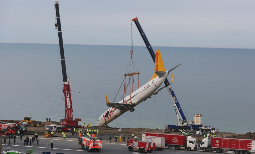 A Pegasus Airlines Boeing 737-800 aircraft, which was skidded off the runway on Saturday, January 13, 2018, is lifted by a crane at Trabzon airport by the Black Sea in Trabzon