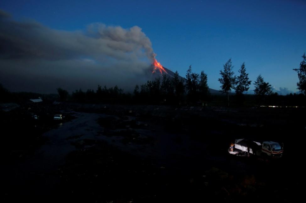 Lava cascades down the slopes of Mayon volcano during its eruption at Daraga