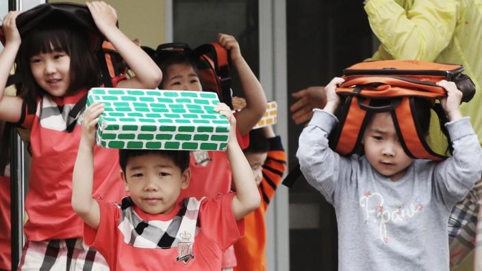 Earthquake drill at kindergarten