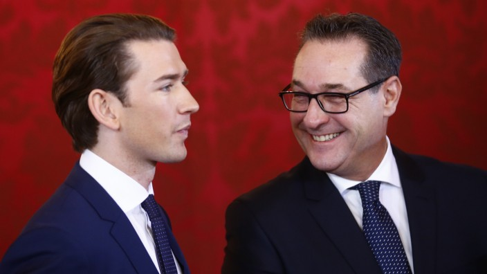 Head of the Freedom Party  Strache and head of the People's Party Kurz react during the swearing-in ceremony of the new government in Vienna