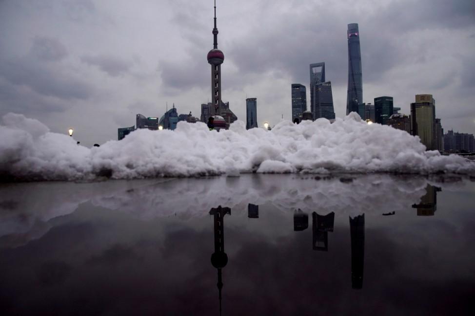 Shanghai's financial district is seen at the Bund promenade as snow falls in Shanghai