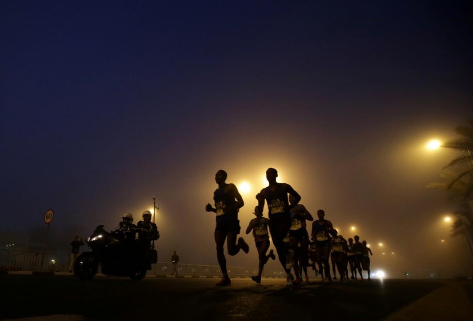 Athletes compete during the Dubai Marathon in Dubai.