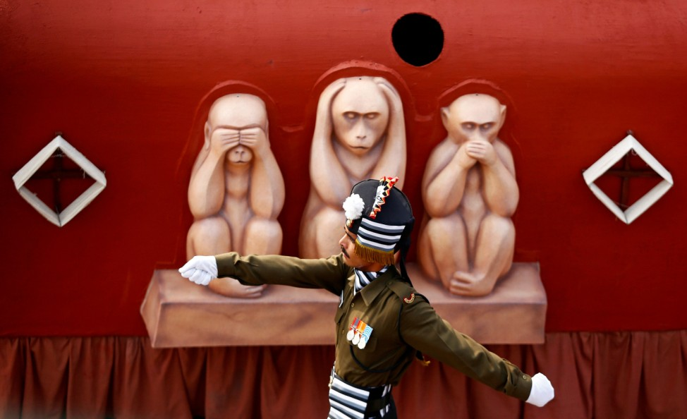 Indian Army soldier marches next to a tableau during the Republic Day parade in New Delhi