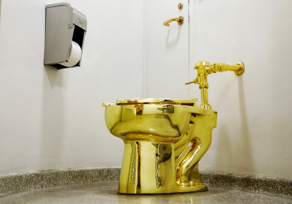 FILE PHOTO:  Maurizio CattelanâÄÖs âĜAmerica,âĝ a fully functional solid gold toilet is seen at The Guggenheim Museum in New York