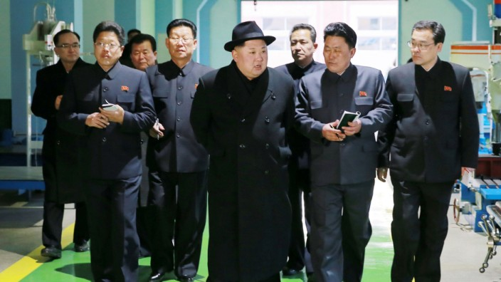 North Korean leader Kim Jong-in inspects a newly established Pyongyang trackless trolley factory