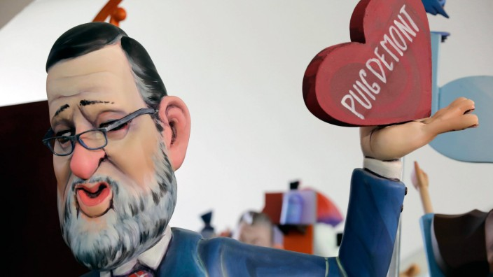A view of a ninot of Spanish Prime Minister Mariano Rajoy holding a heart with the name of Catalan p