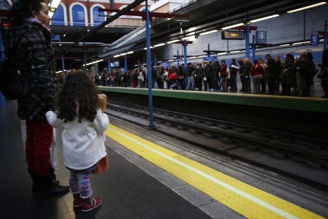 Passengers wait for the subway during a 48-hour strike by metro workers to protest against salary cuts in Madrid