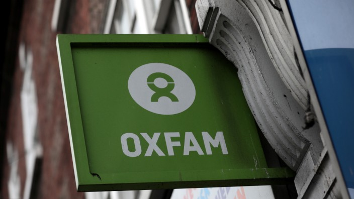 A sign is seen above a branch of Oxfam, in central London