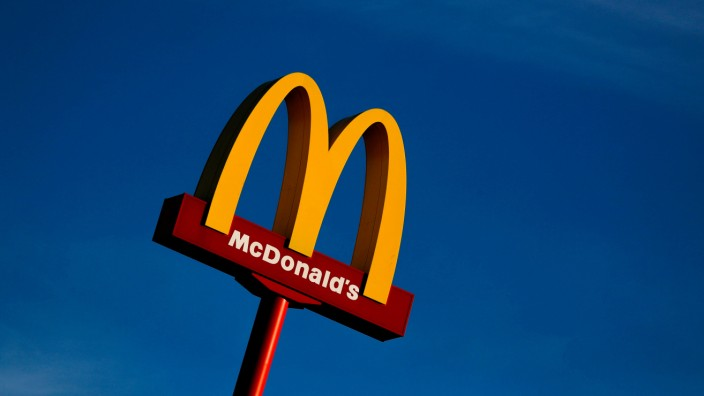 A sign for the U.S. fast food restaurant chain McDonald's is seen outside one of their restaurants in Sint-Pieters-Leeuw
