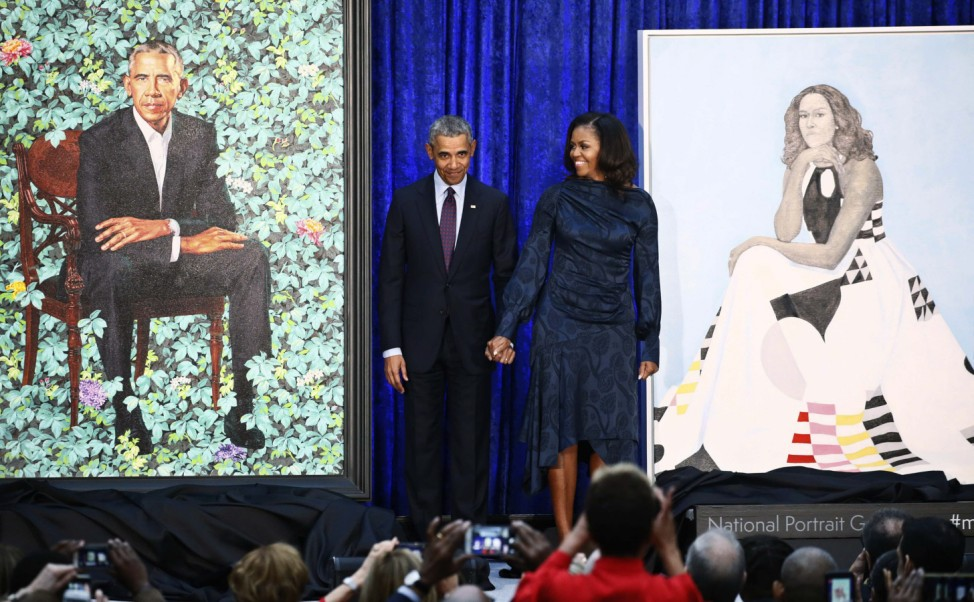 Former U.S. President Obama and first lady Michelle Obama stand with portraits during unveiling ceremony at the SmithsonianâÄÖs National Portrait Gallery in Washington