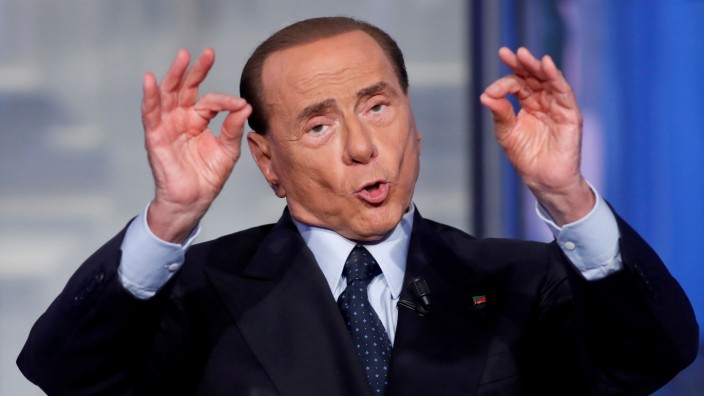 FILE PHOTO - Italy's former PM Berlusconi gestures during the television talk show 'Porta a Porta' in Rome, Italy.