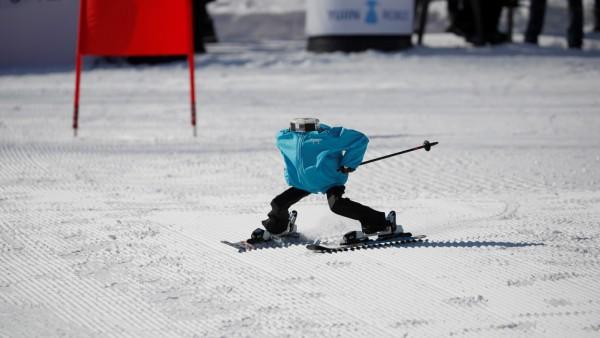 Robot Tae Kwon V skies during the Ski Robot Challenge at a ski resort in Hoenseong
