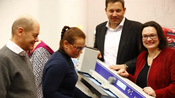 Nahles, Klingbeil and Scholz of Social Democratic Party (SPD) react as party member counts ballot papers of the voting for a possible coalition between the SPD and the CDU in the SPD headquarters in Berlin
