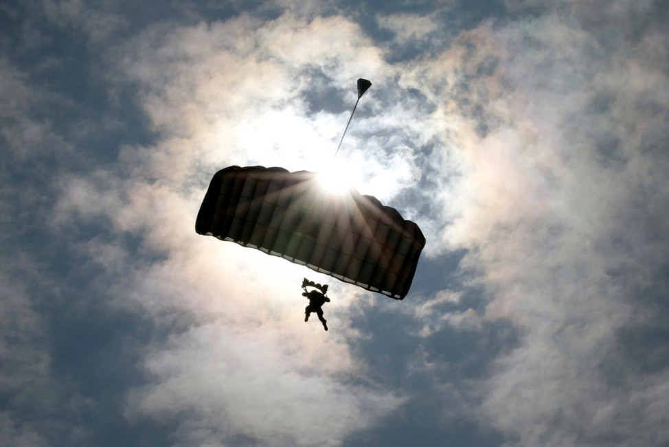 A U.S. Marines' member takes part in parachute drops during their joint exercise with Japan Ground Self Defense Force, named Northern Viper 17 at Hokudaien exercise area in Eniwa