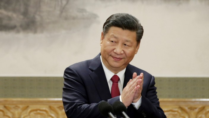 FILE PHOTO: China's President Xi Jinping claps after his speech in Beijing