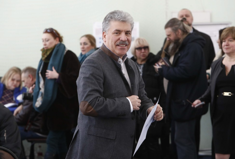 Presidential candidate Grudinin visits a polling station during the presidential election outside Moscow