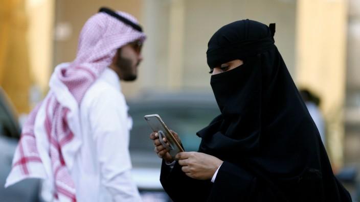 FILE PHOTO:Saudi woman uses the Careem app on her mobile phone in Riyadh