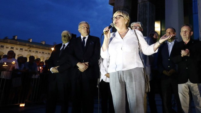 Head of the Poland's Supreme Court Gersdorf speaks to protesters during a demonstration against judicial reforms in Warsaw