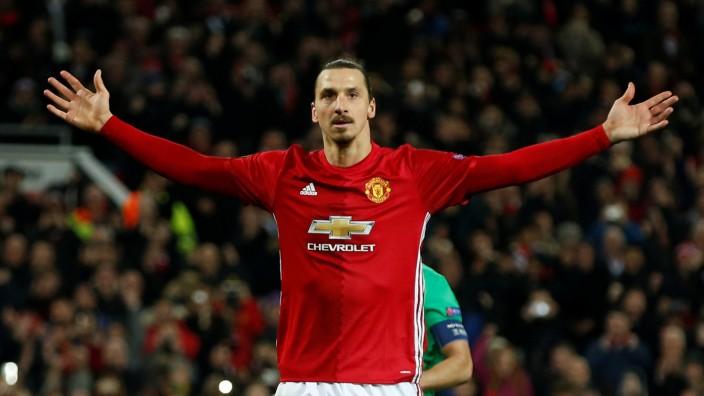 FILE PHOTO: Manchester United's Zlatan Ibrahimovic celebrates scoring their third goal to complete his hat trick