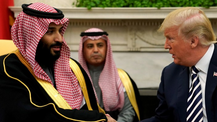 FILE PHOTO: U.S. President Donald Trump shakes hands with Saudi Arabia's Crown Prince Mohammed bin Salman in the Oval Office at the White House in Washington