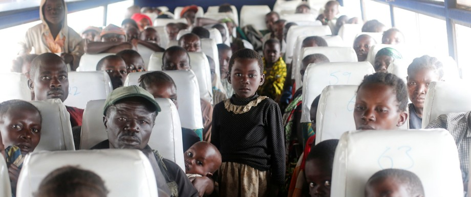 Congolese families, who fled ethnic fighting in Democratic Republic of Congo on a boat across Lake Albert, sit in a bus upon arrival at United Nations High Commission for Refugees (UNHCR) settlement camp in Kyangwali,