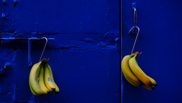 Bunches bananas hang on the door of  'All Season', a greengrocer's shop in Valletta