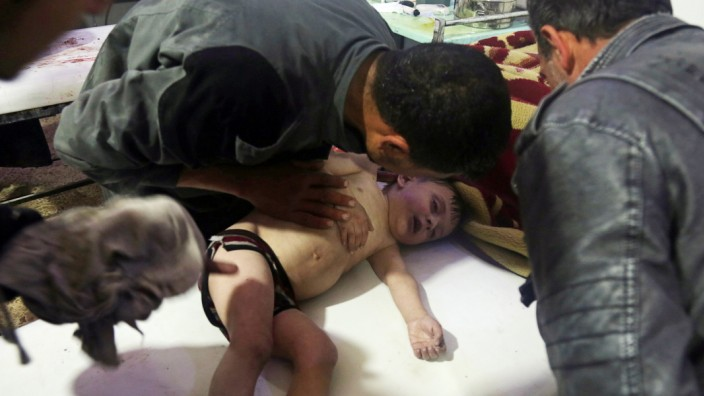 A child is treated in a hospital in Douma, eastern Ghouta in Syria, after what a Syria medical relief group claims was a suspected chemical attack